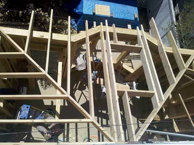 Keith Mazzarello framing the hip roof on our kitchen extension