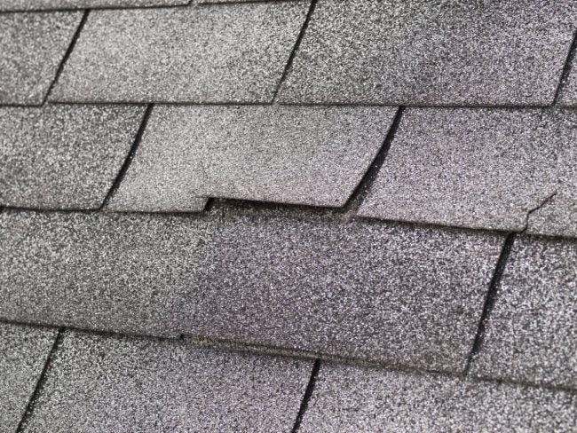 Repairing a Leaky Roof's Curled Shingles