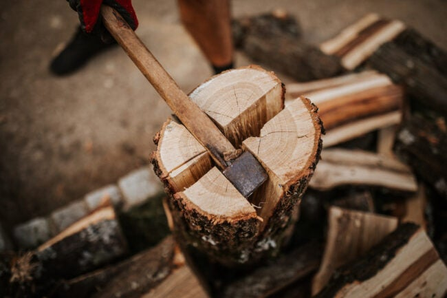 how to stack firewood splitting log