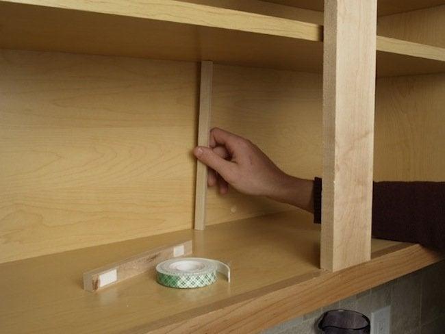 Supports for sagging cabinet shelves