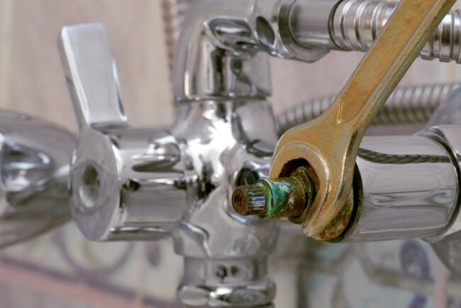 how to fix a leaky faucet -- replacing defective ceramic disc cartridge covered with limescale in shower mixer using wrench