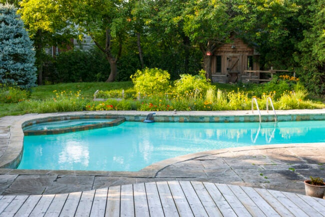 Swimming Pools 101 - Wood and Stone Decking