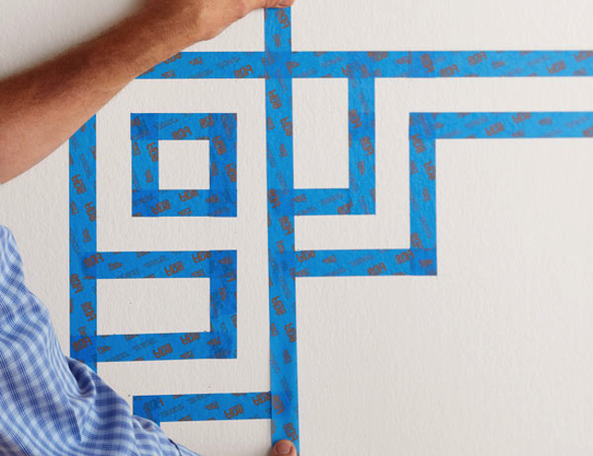 How to Paint Stripes on a Wall - Taping