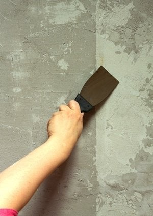 How to Fix Cracks in Concrete - Putty Knife