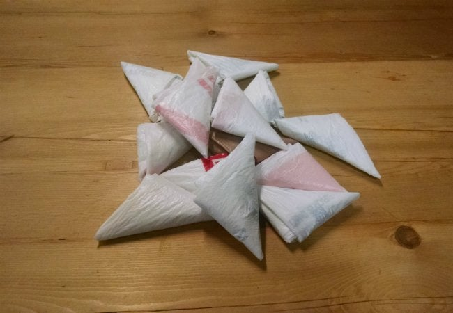 How To Store Plastic Bags - Fold into Triangles