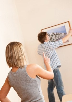 Hang a Picture with a Paint Stirrer - Couple