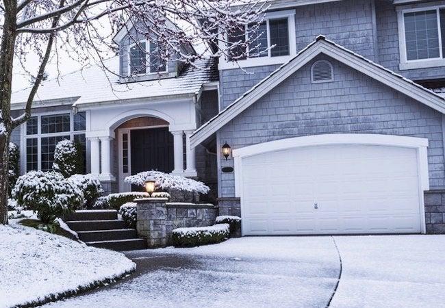 Repairing vs. Replacing a Furnace - House in Winter