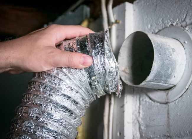 flexible-aluminum-dryer-vent-hose-removed-for-picture-id1145295019
