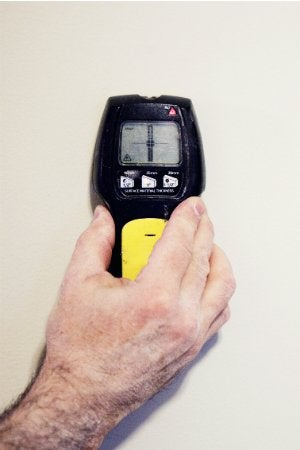 How to Use a Stud Finder to Locate Studs