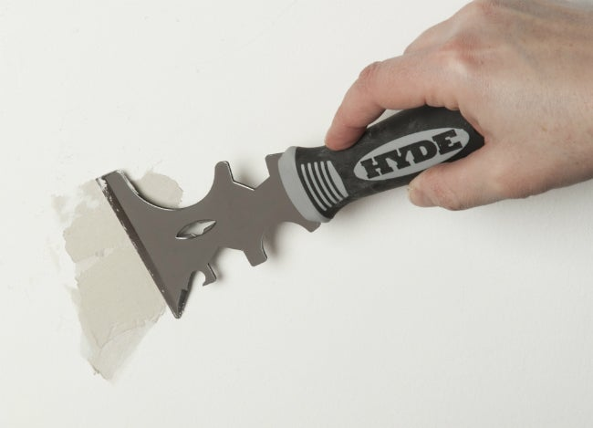 Scrape Away Lumps of Dried Paint with the HYDE 17-in-1 Painter's Tool
