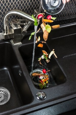 How to Fix a Leaking Garbage Disposal Yourself