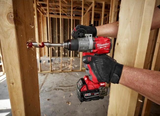 milwaukee hammer drill drilling through stud