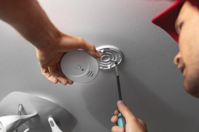How To Install a Smoke Detector: Install the Mounting Bracket