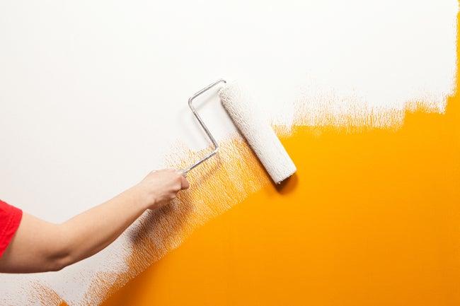 painting yellow wall white