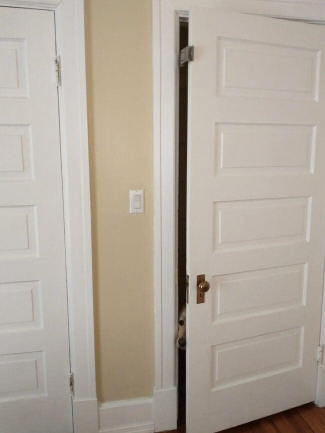 Door latch blocking dog from entering room
