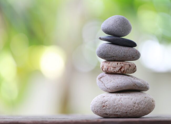 balance-stones-stacked-to-pyramid-in-the-soft-green-background-picture-id1041545006