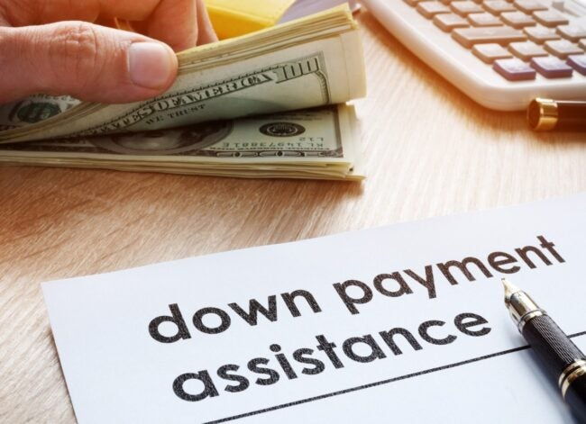 down-payment-assistance-form-and-dollar-banknotes-picture-id961842610