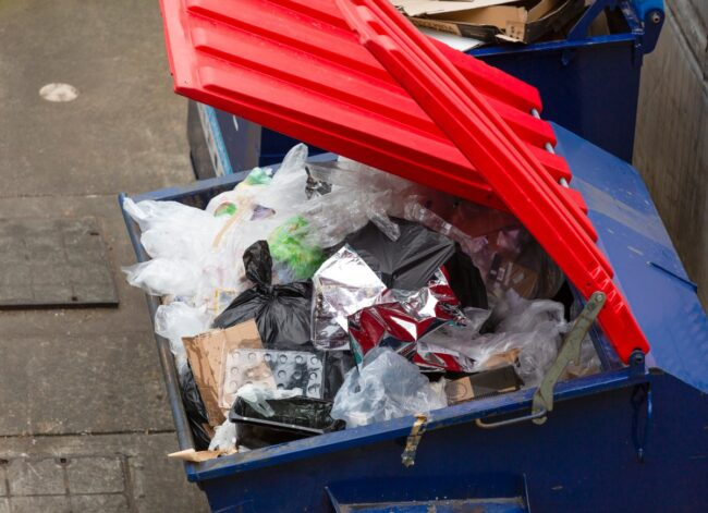 garbage-bin-full-of-plastic-vaste-background-with-copy-space-picture-id1197004576
