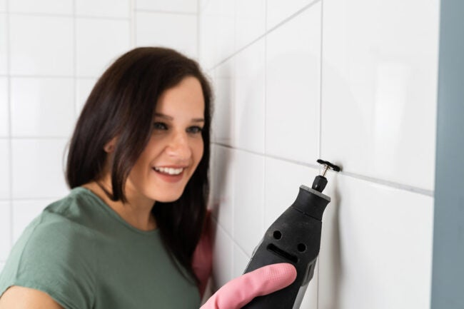 Removing the Damaged Grout with Grout Saw