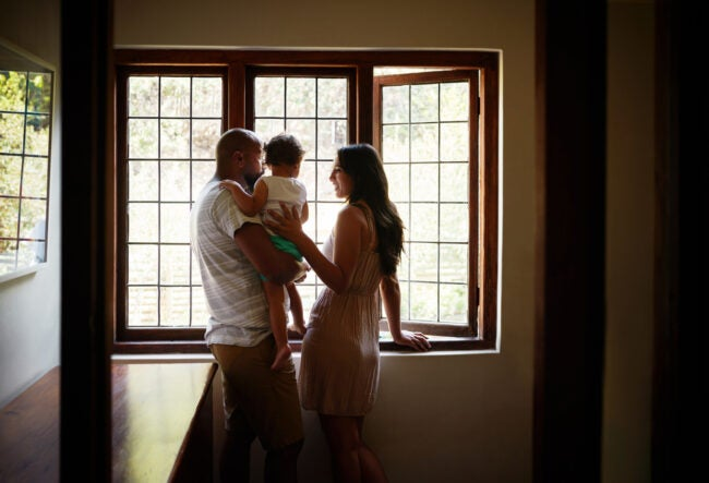 family looking out large thermal window