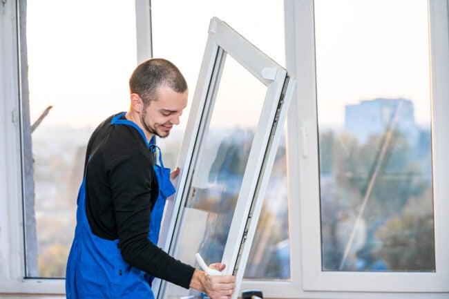 professional installing thermal pane windows