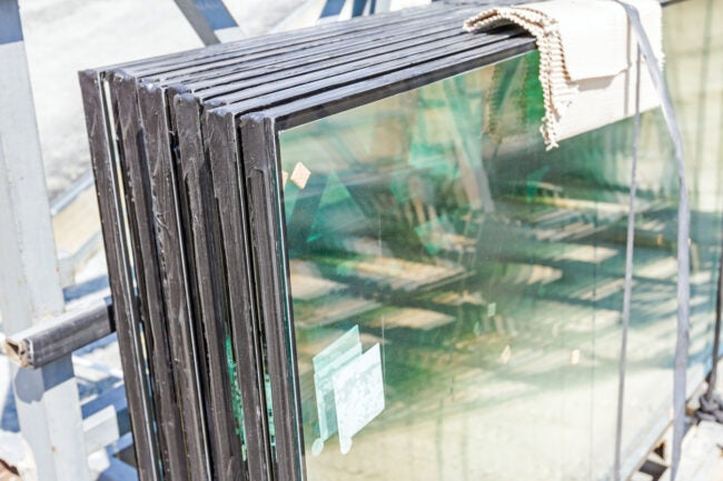 Double glazed glass window stacked and ready for build in.