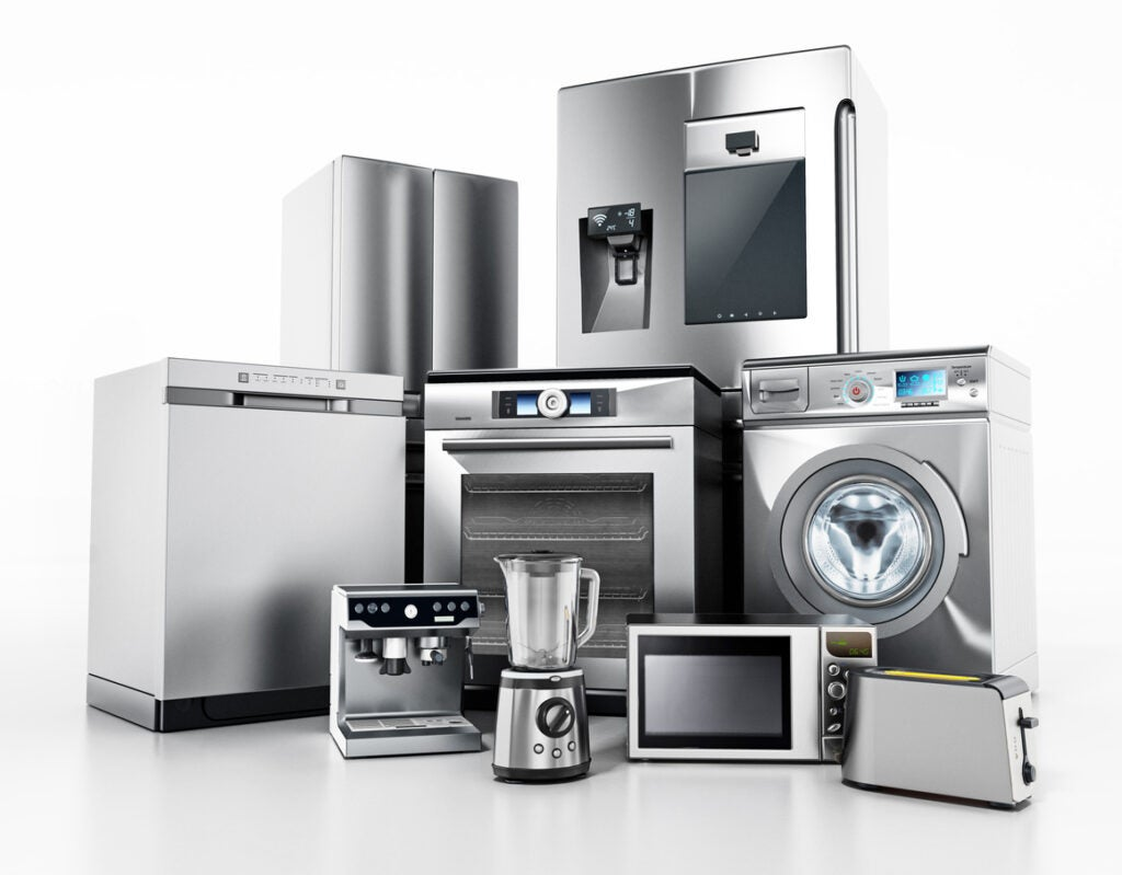 Set of contemporary house appliances isolated on white