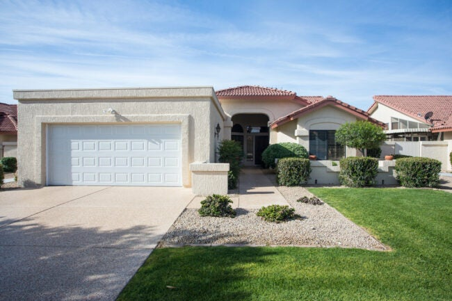 house in desert with front lawn of ornamental grass