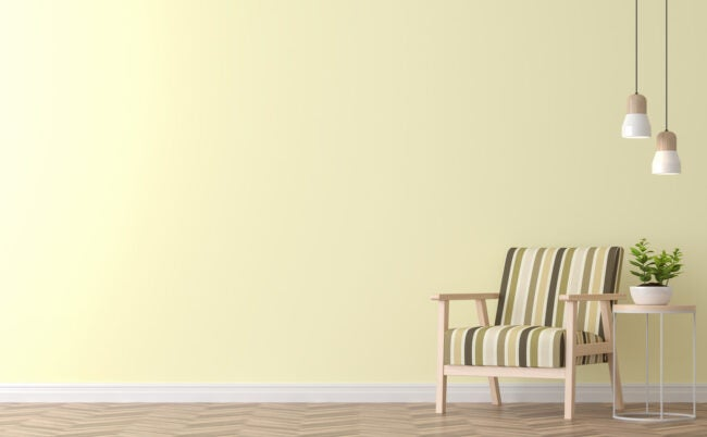 Modern vintage living room with yellow wall 3d rendering image.There are yellow paint wall and wood floor ,Funished with vintage wood chair