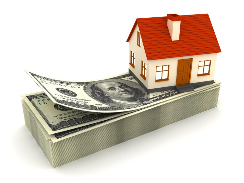 House on a stack of dollars