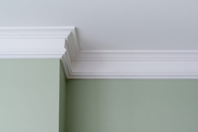 Details in the interior. Ceiling moldings, part of intricate corner