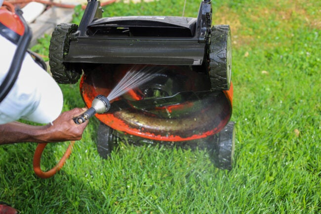 lawn mower repair cleaning the deck