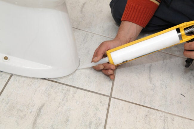 caulking toilet to the floor