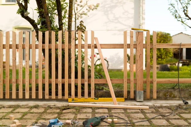 building a new wooden natural fence - work tools
