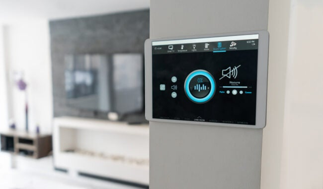 Close-up on a home automation system controlling the music at the house - smart home concepts