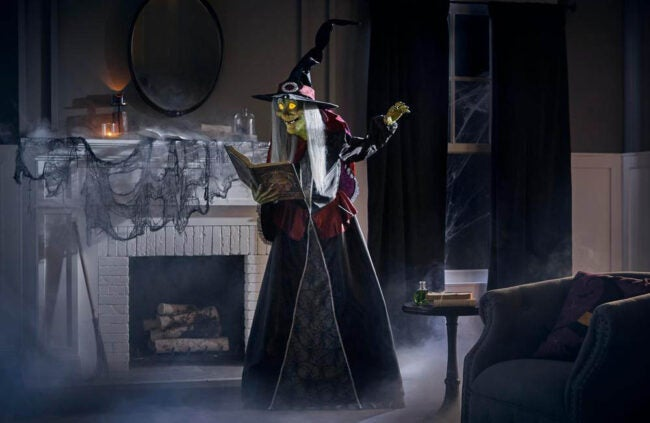 The Best Halloween Decorations Option: 7 ft LED Spellcasting Witch