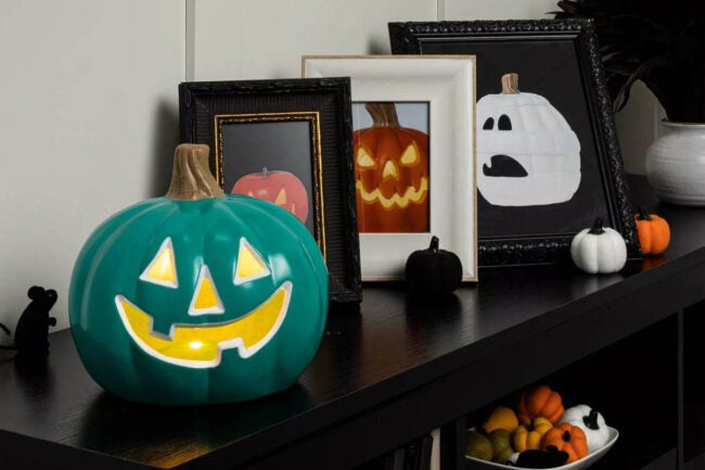 The Best Halloween Decorations Option: 9 Teal Lit Pumpkin with Happy Face
