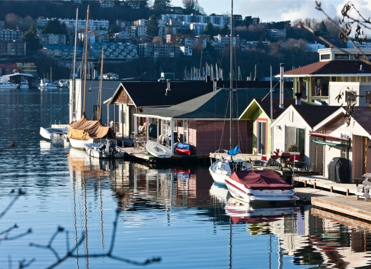 16 Charming Towns Where You Can Live on a Houseboat